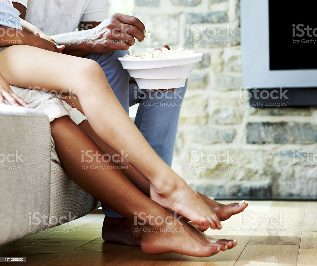 Family sitting on couch watching TV royalty-free stock photo