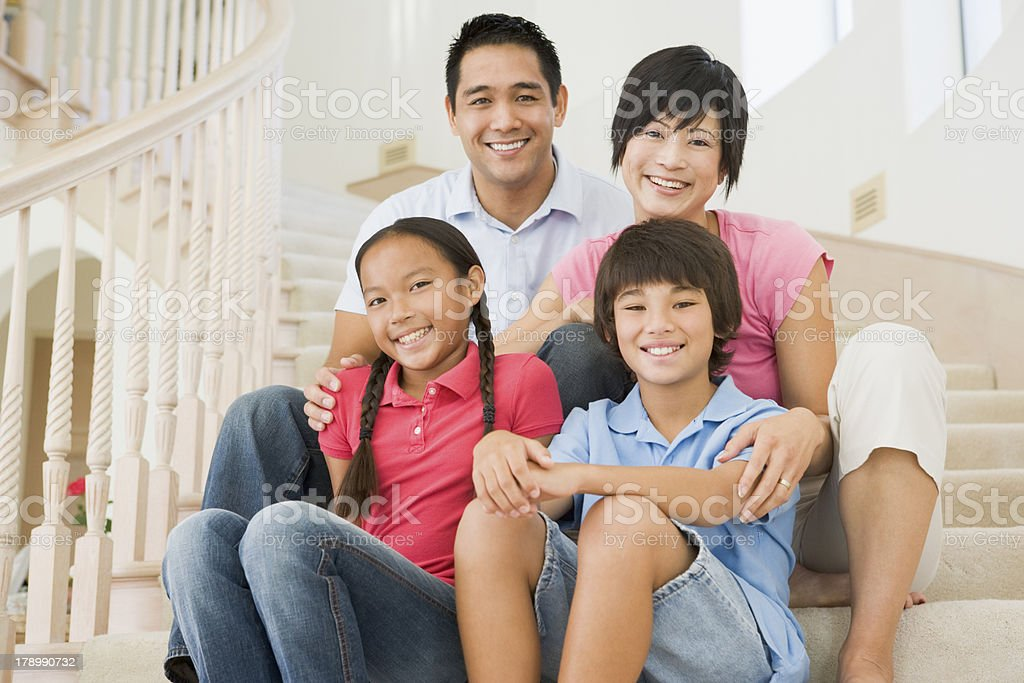 Family sitting on staircase royalty-free stock photo