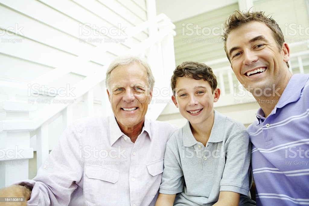 Family sitting on staircase smiling royalty-free stock photo