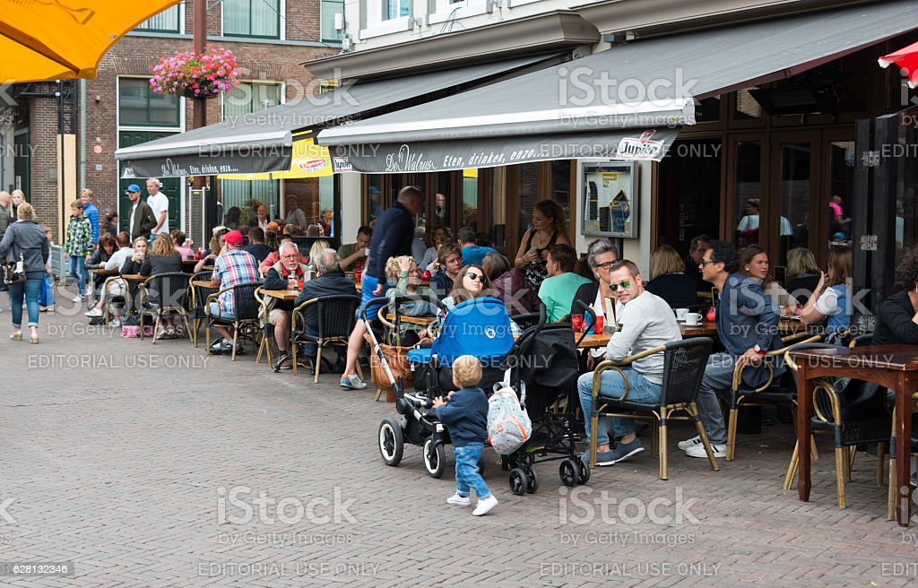 family sitting on teracce stock photo