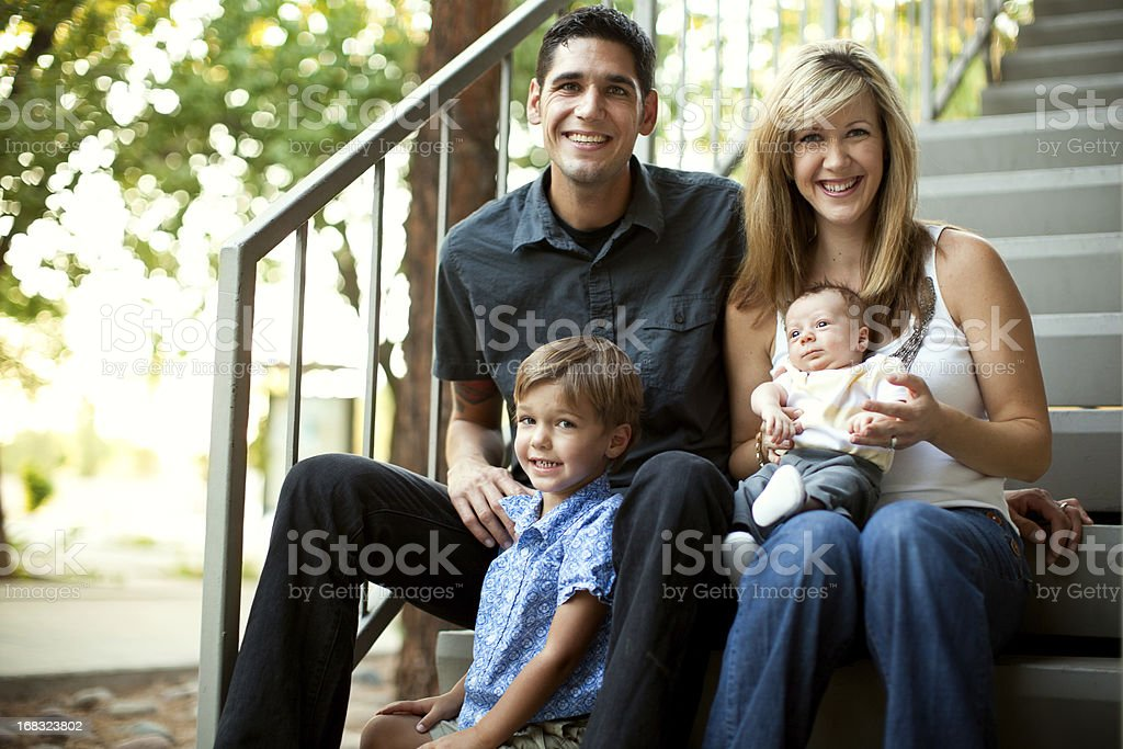 Family Sitting Outdoors by Home royalty-free stock photo