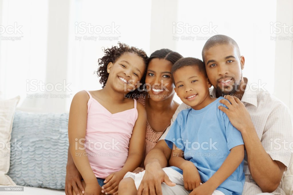 Family sitting together on a sofa at home royalty-free stock photo