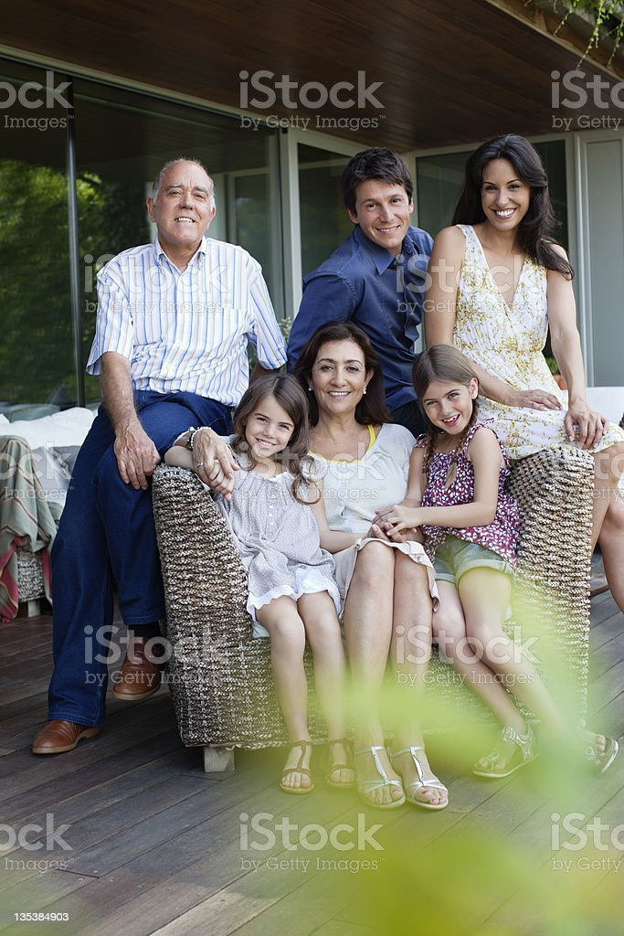 Family sitting together on patio royalty-free stock photo
