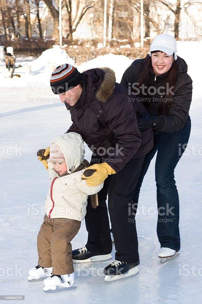 Family skating at the rink royalty-free stock photo