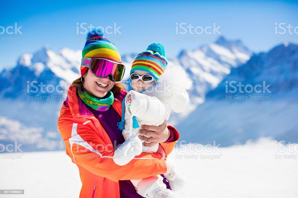 Family ski and snow fun in winter mountains stock photo