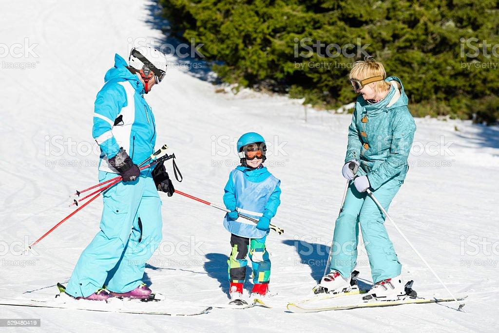 Family skiing stock photo