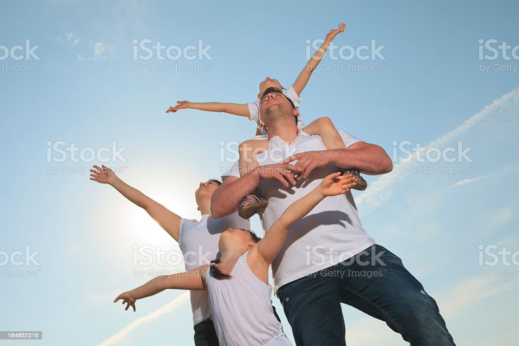 Family Sky - Hand in the Air royalty-free stock photo