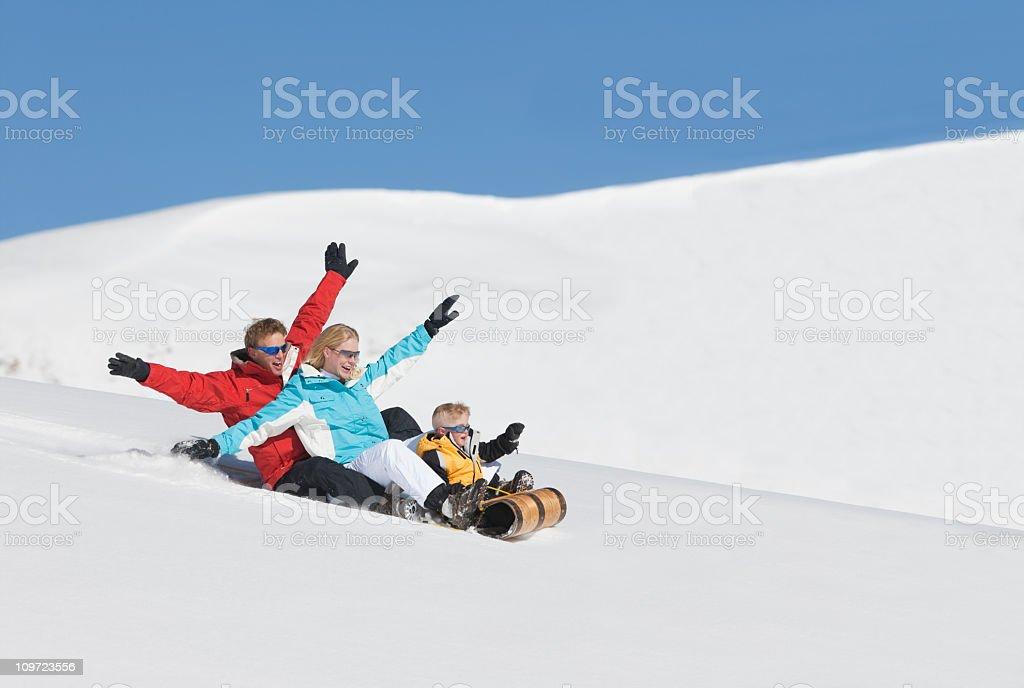 Family Sledding In Colorado royalty-free stock photo