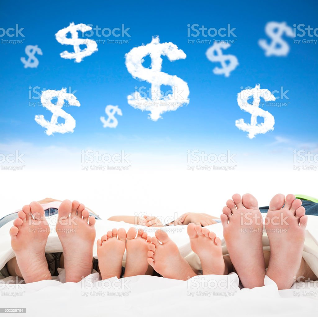 family sleeping on the bed with money sign concept stock photo