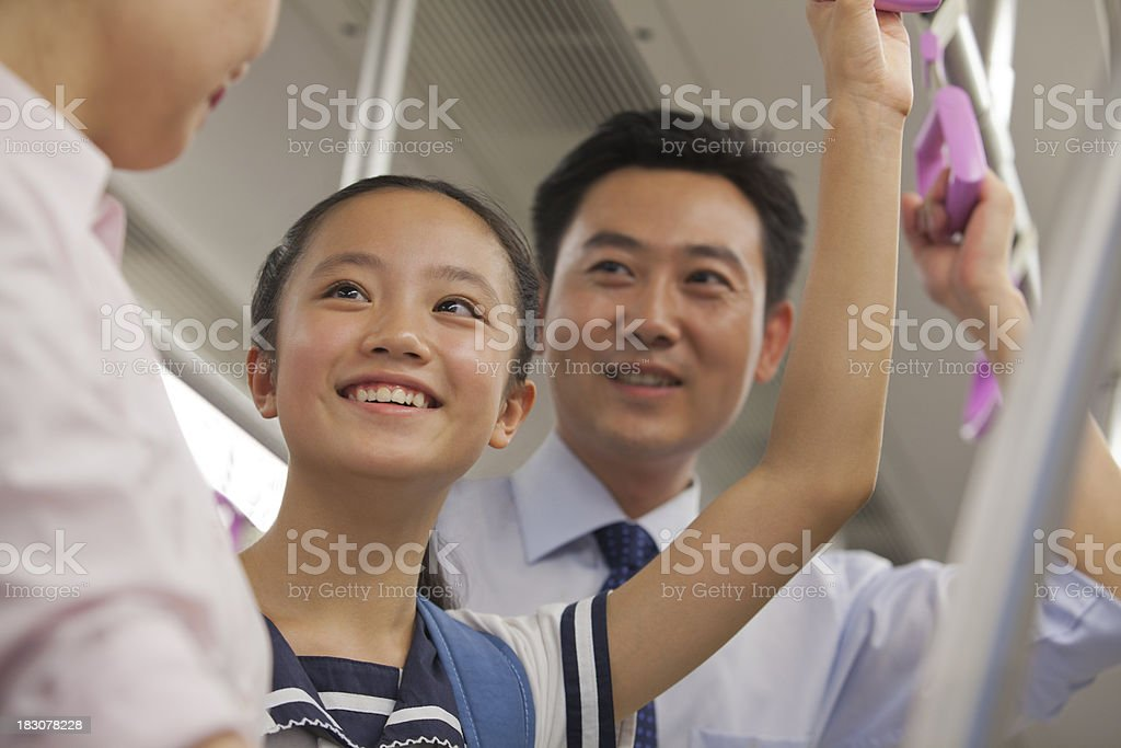 Family smiling in the subway royalty-free stock photo