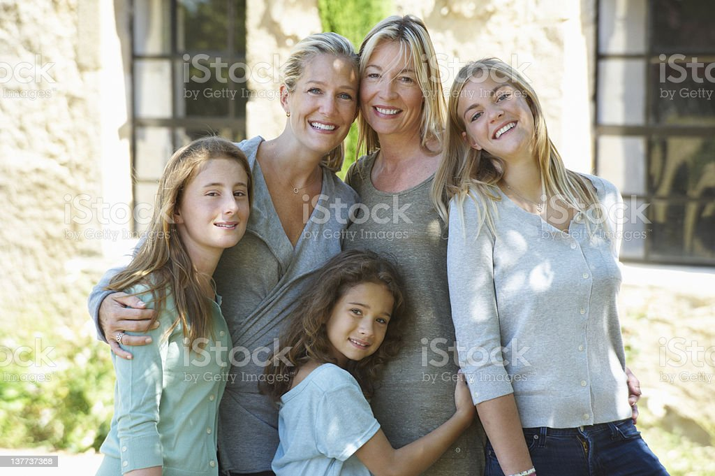 Family smiling together outdoors stock photo