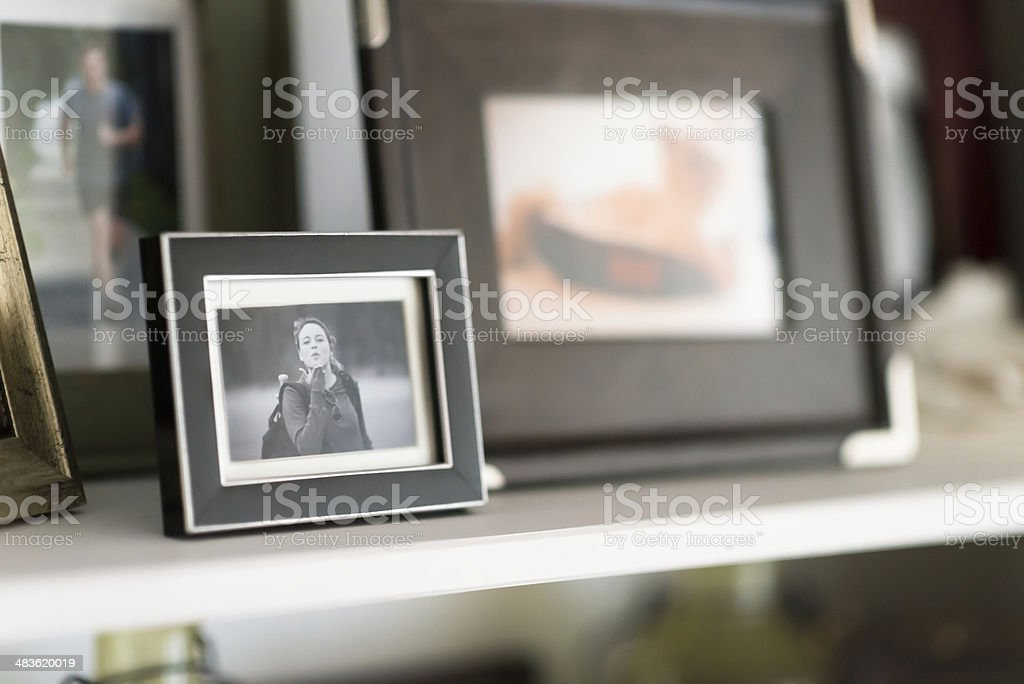 Family Snapshots Framed on Shelf stock photo