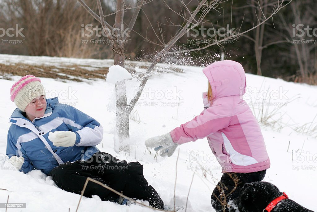 Family Snowball Fight royalty-free stock photo