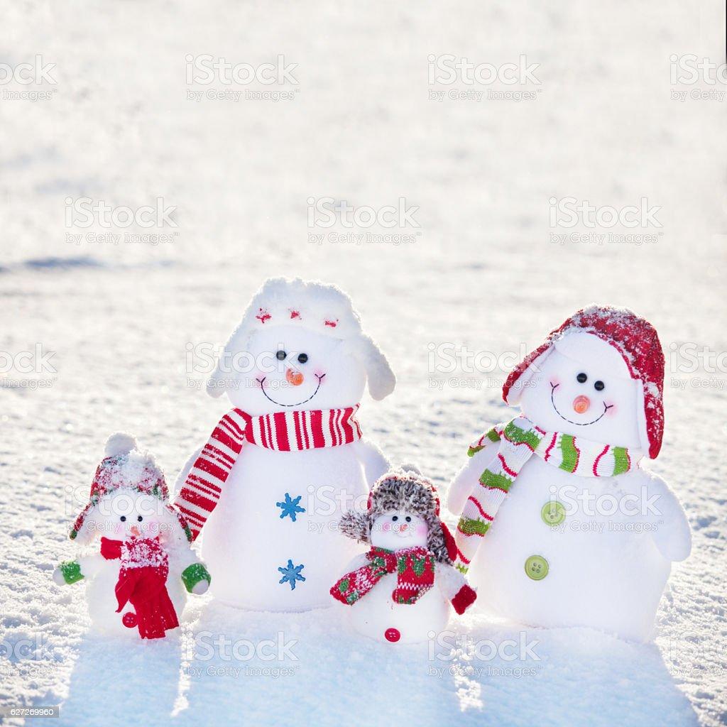 Family snowman on snow stock photo