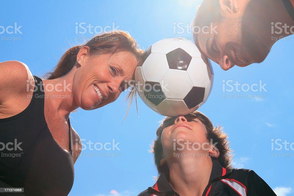 Family Soccer - Funny Ball on Forehead royalty-free stock photo