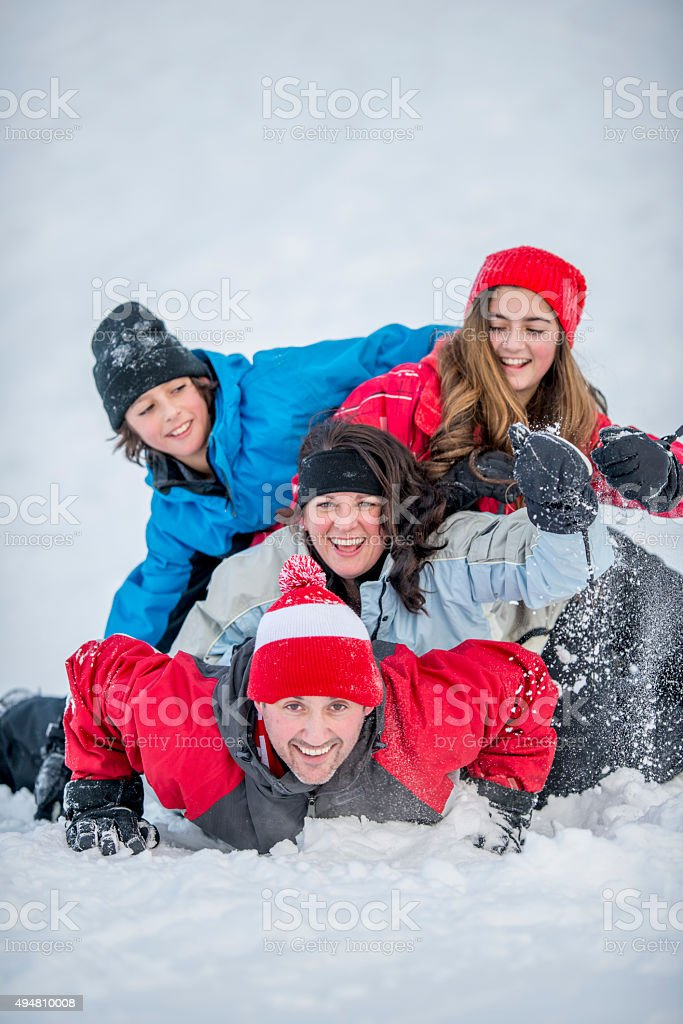 Family Stacked in a Dog Pile stock photo
