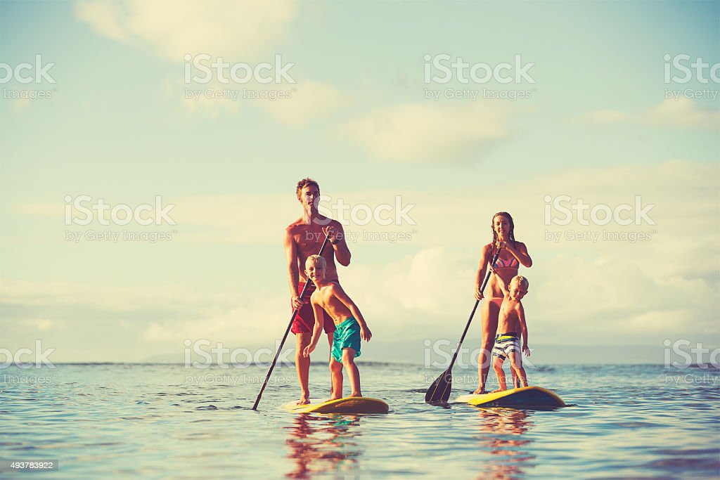 Family Stand Up Paddling stock photo