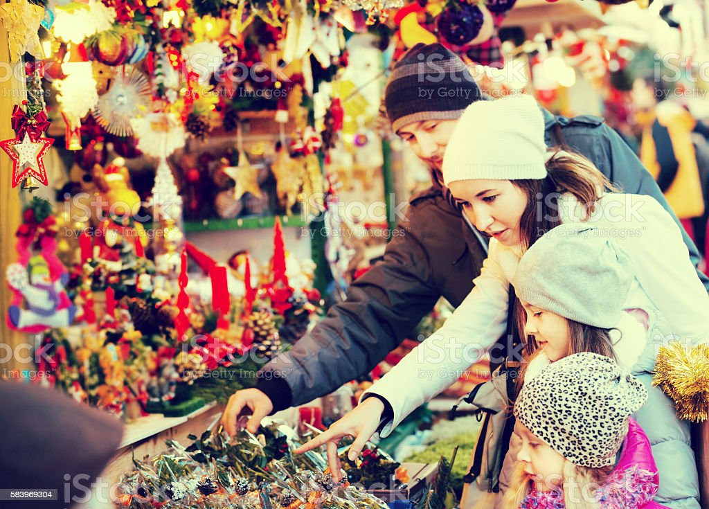 Family standing at coniferous souvenirs counter stock photo