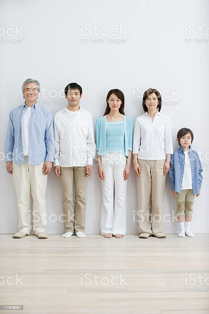 Family standing in a row royalty-free stock photo