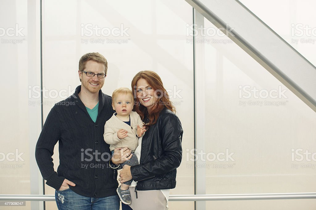 Family Standing in Front of Wall stock photo