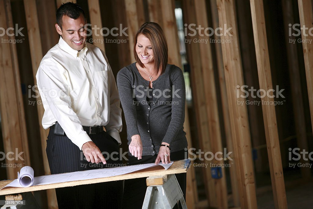 Family standing inside their new home royalty-free stock photo