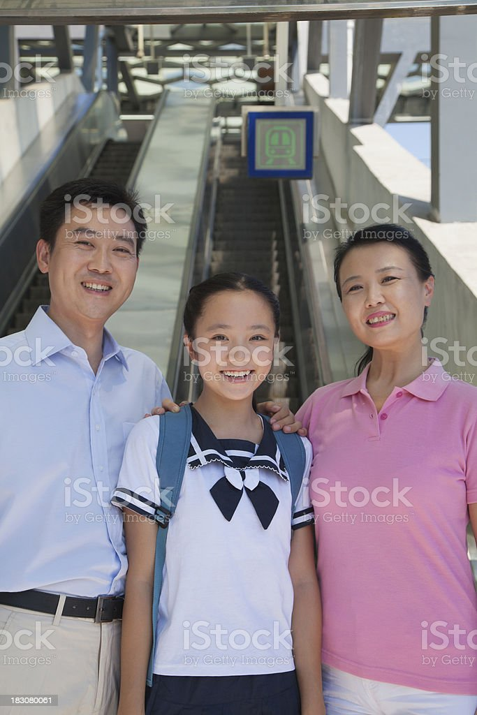 Family standing next to the escalator near subway station royalty-free stock photo