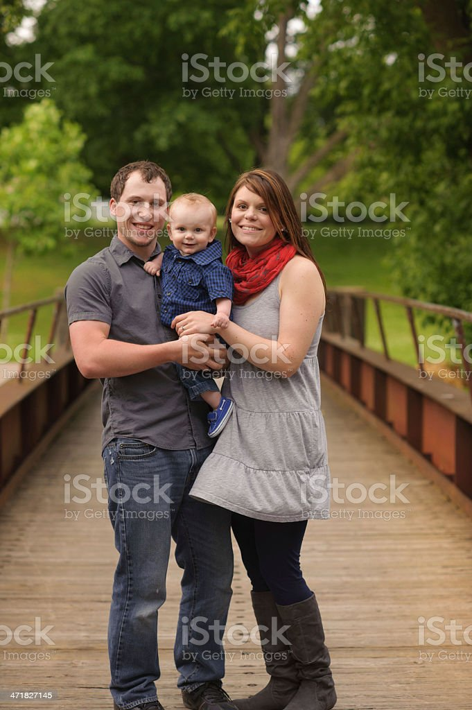 Family Standing on Bridge Outside royalty-free stock photo