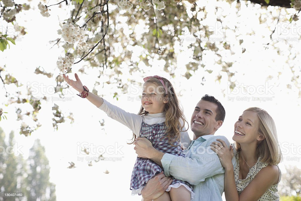 Family standing outdoors royalty-free stock photo