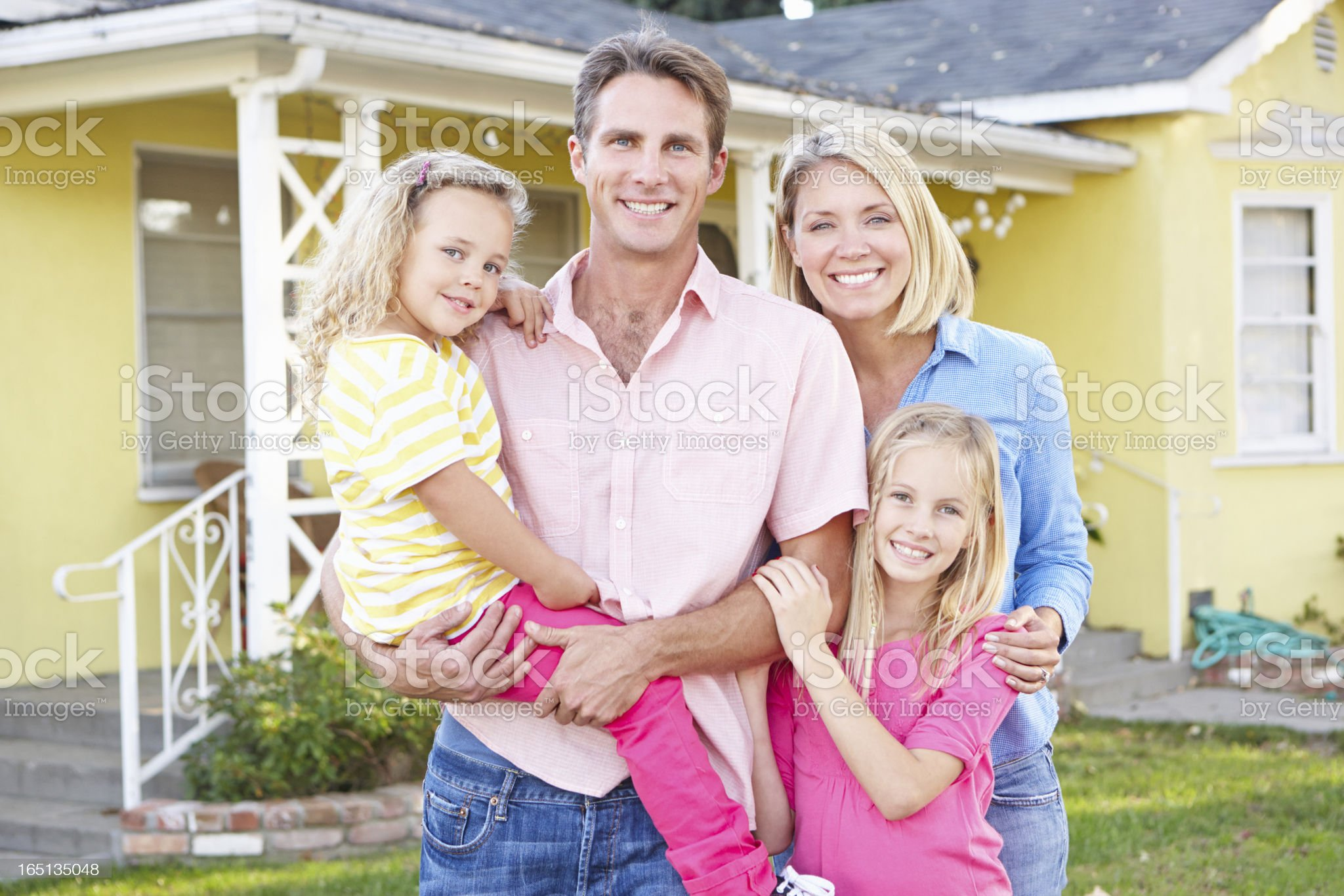 Family Standing Outside Suburban Home royalty-free stock photo