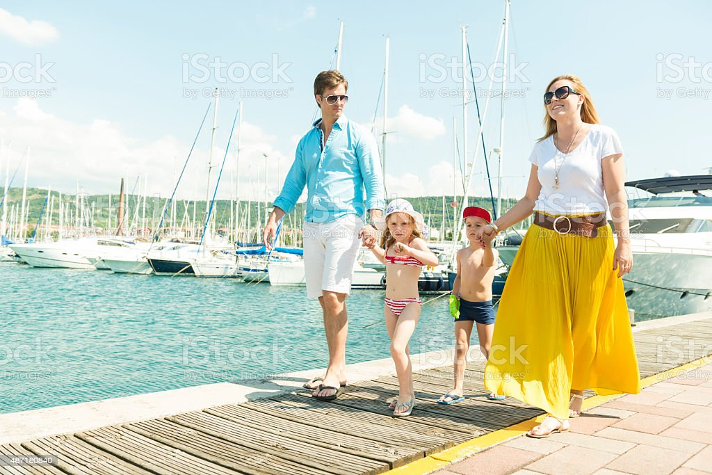 Family strolling on a pier stock photo