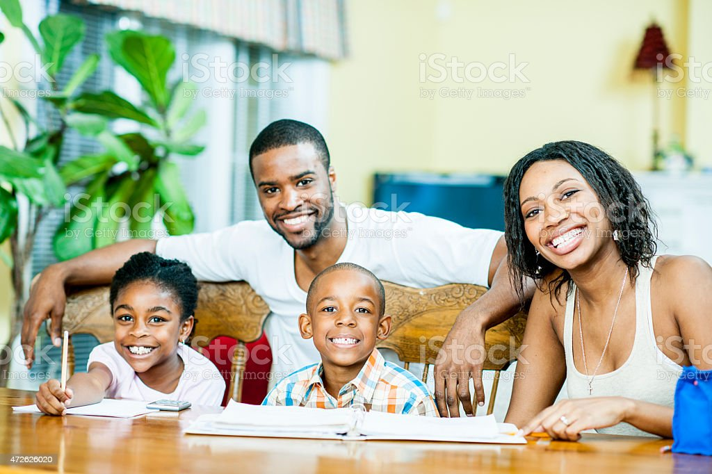 Family Studying together and Posing for Picture stock photo