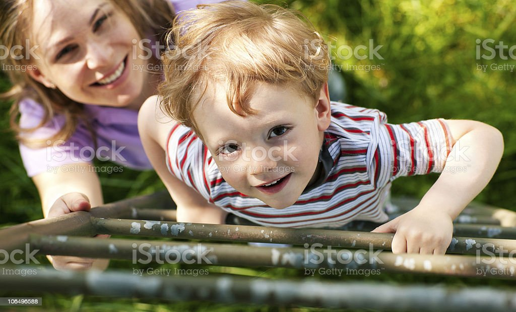 Family summer on ladder to tree house royalty-free stock photo