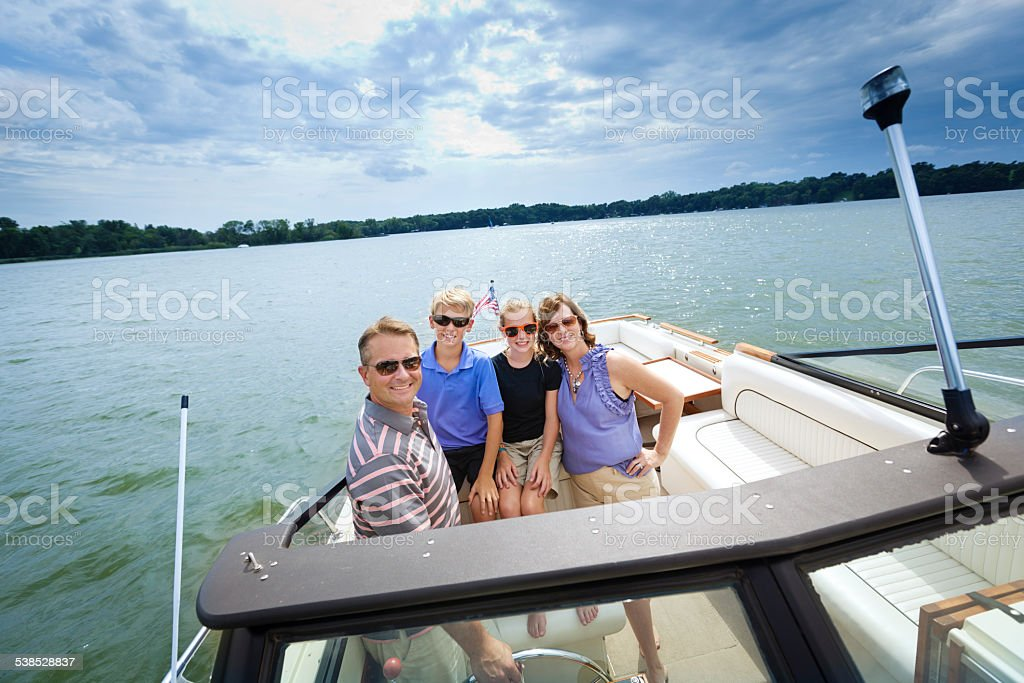 Family Summer Vacation Boating in Lake stock photo