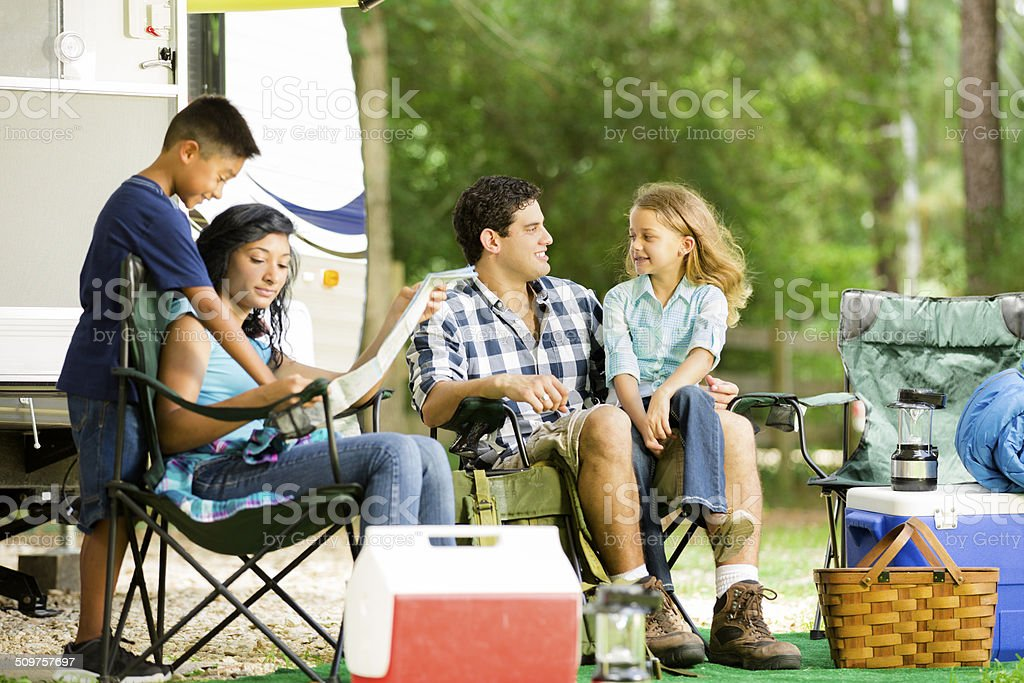 Family summer vacation. Motor home parked at national park campground. stock photo