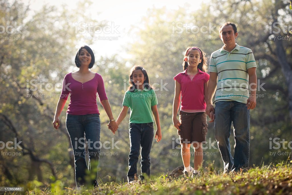 Family taking a walk through the woods royalty-free stock photo