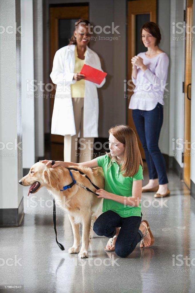 Family taking pet to the vet royalty-free stock photo