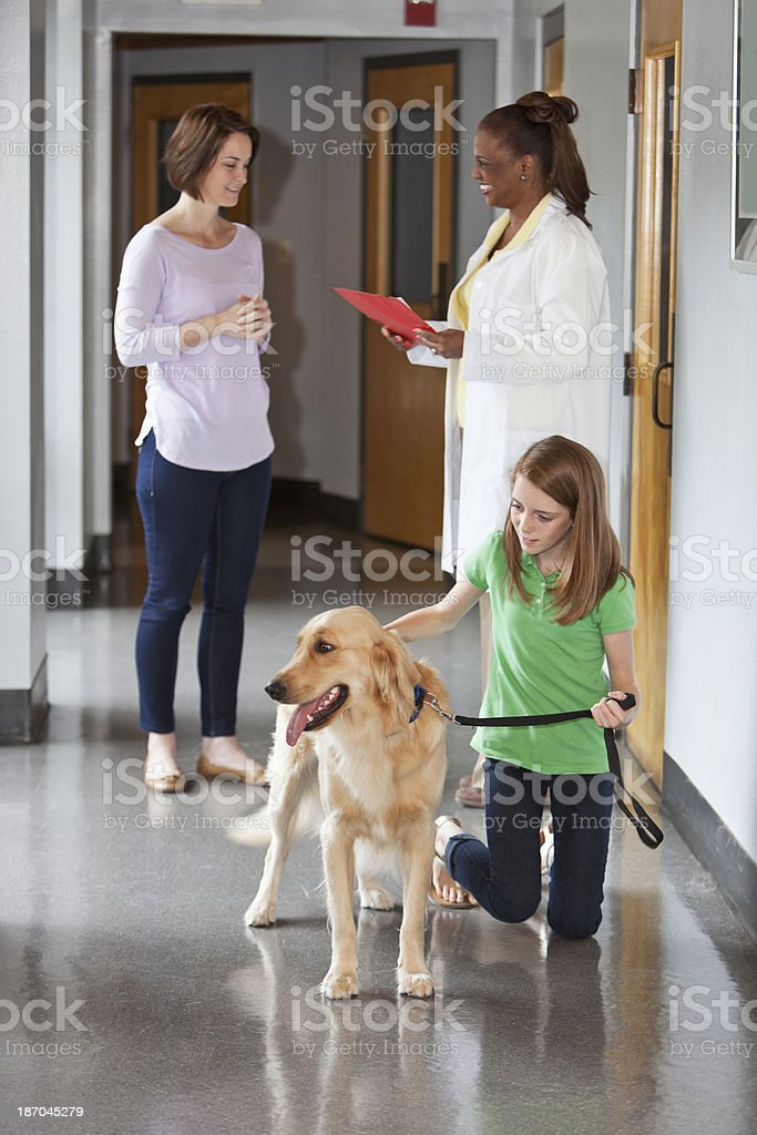 Family taking pet to the vet royalty-free stock photo