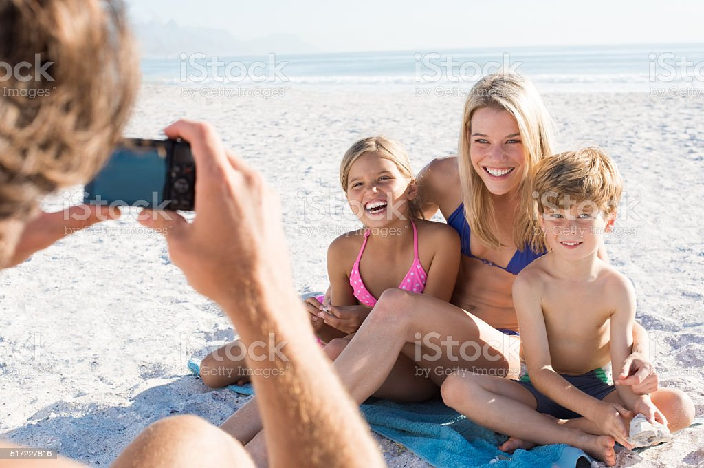 Family taking picture stock photo