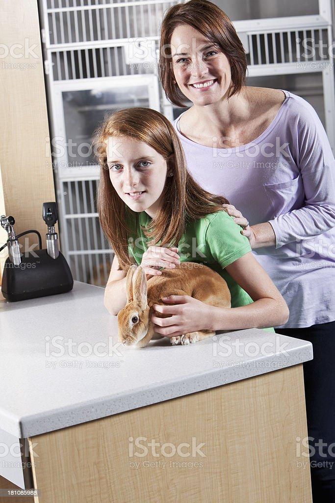 Family taking rabbit to vet royalty-free stock photo