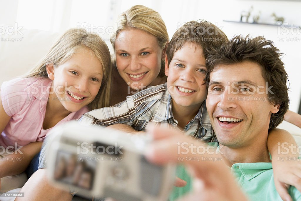 Family taking self portrait with digital camera royalty-free stock photo
