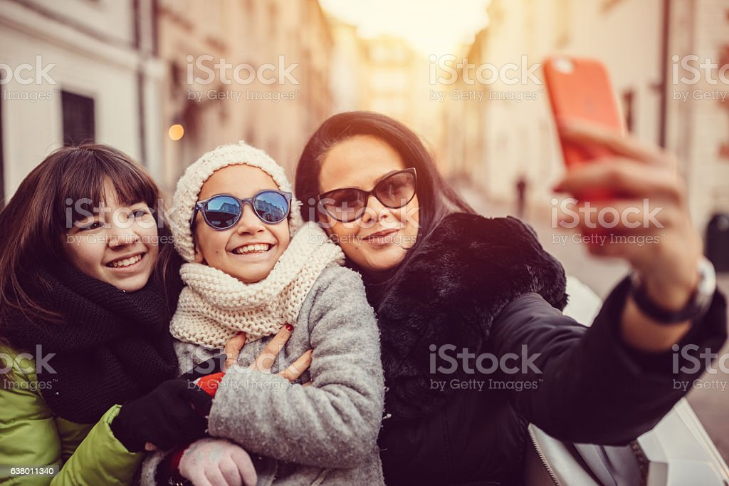 Family taking selfie in Krakow stock photo