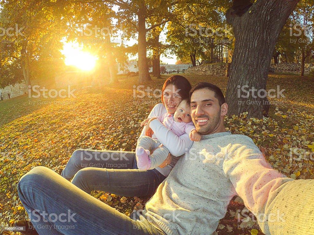 Family taking selfie in the park stock photo