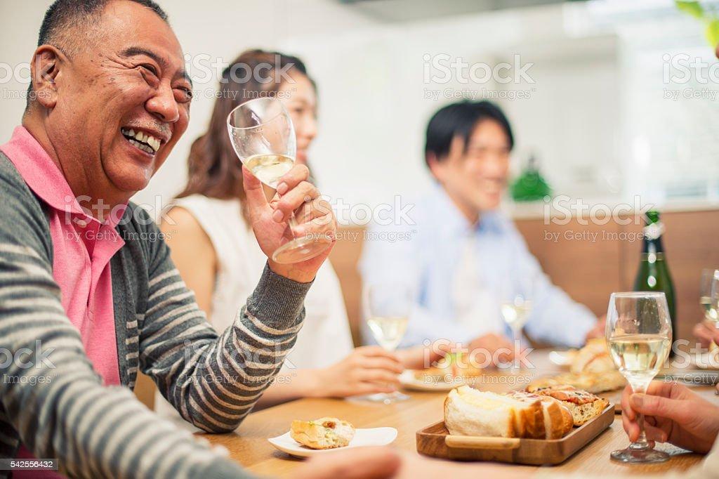 Family talking at home stock photo