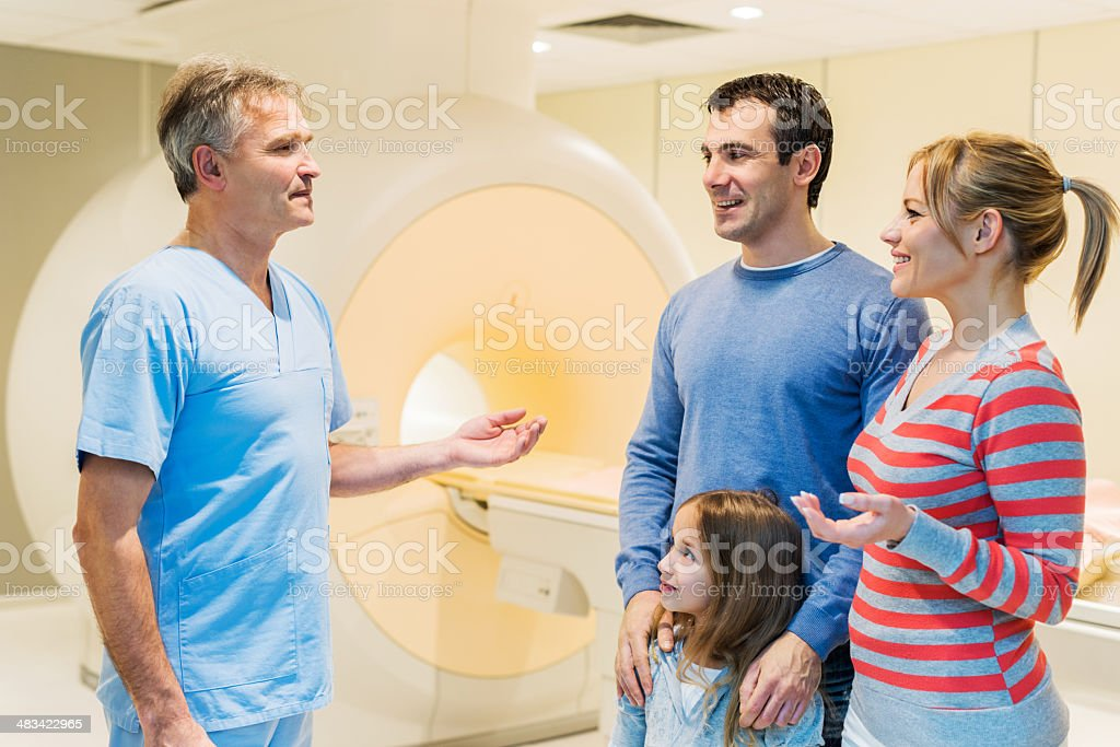 Family talking to a doctor. royalty-free stock photo