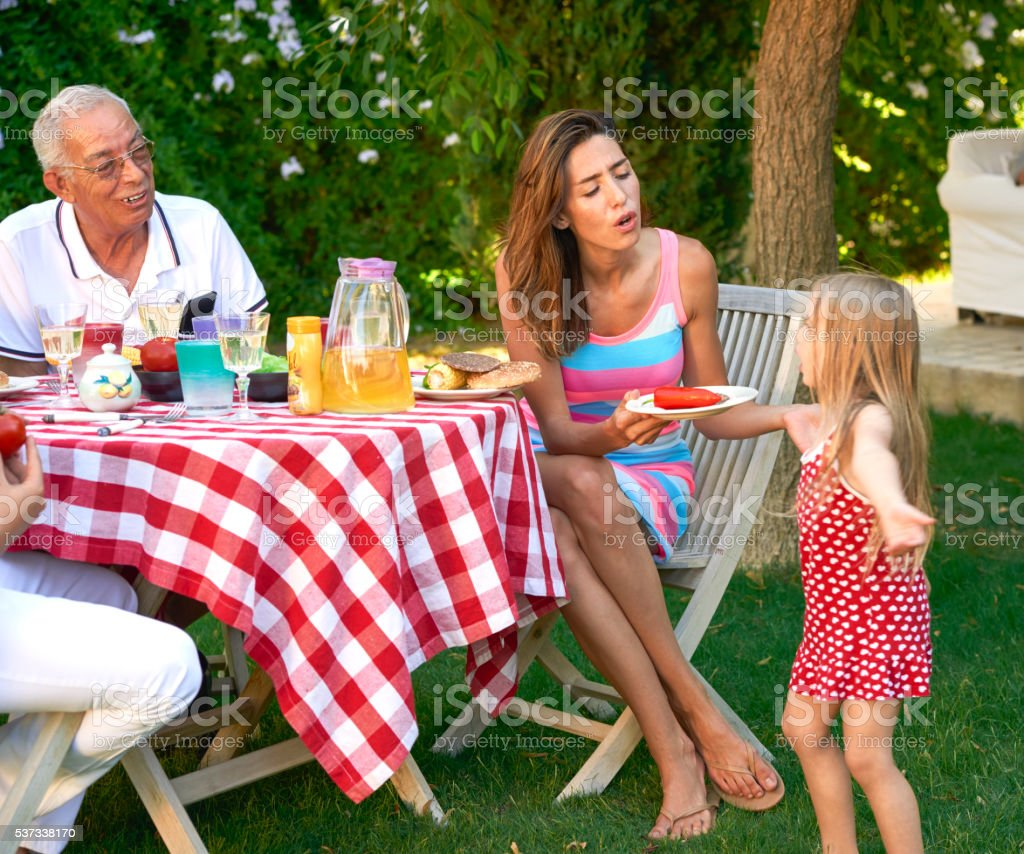 Family tea time in their backyard. stock photo