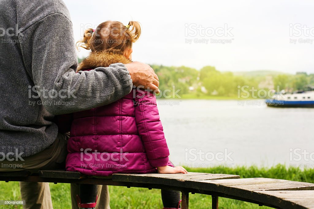 Family time near the river. stock photo