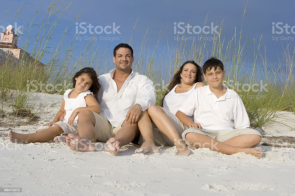 Family time on a beach royalty-free stock photo