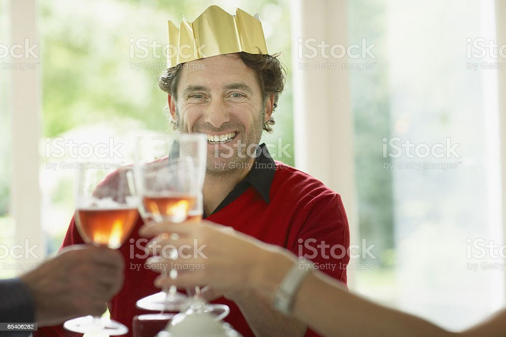 Family toasting at Christmas dinner stock photo