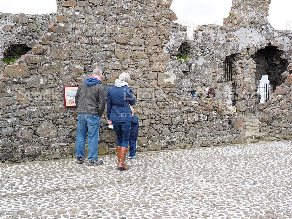 family tourist in dunluce castle stock photo