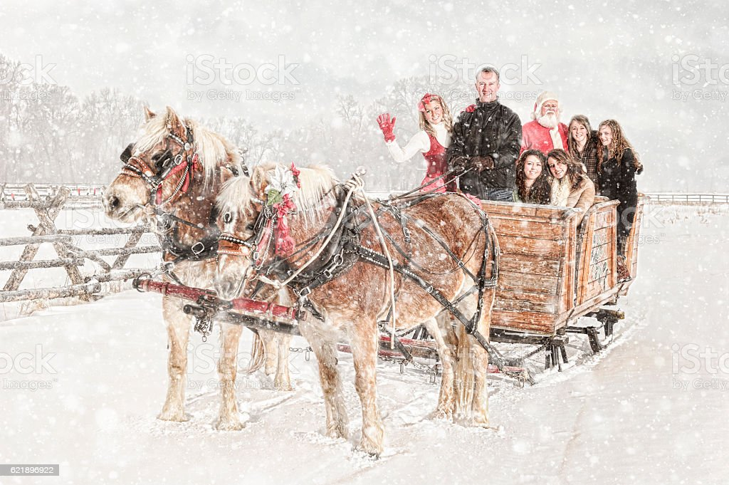 Family Traditions - Christmas Sleigh Ride With Santa stock photo